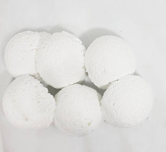 small white tablets shaped like snowballs