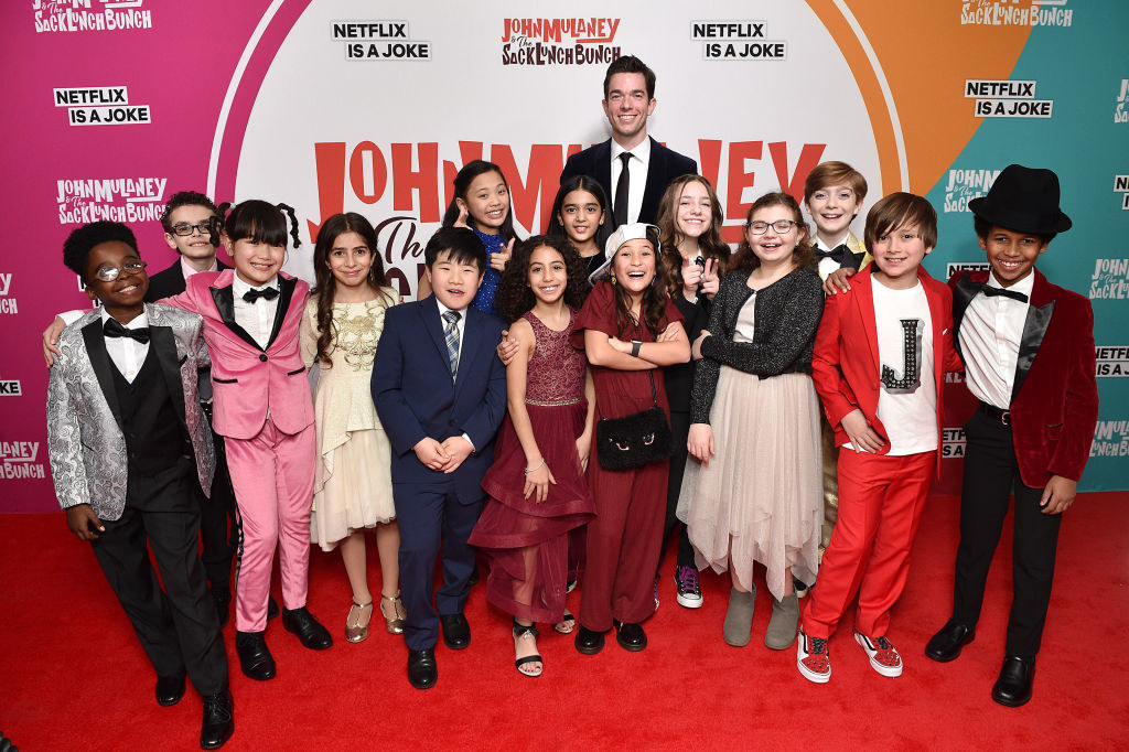 "John Mulaney and the kids of the ""Sack Lunch Bunch"" cast on the red carpet"