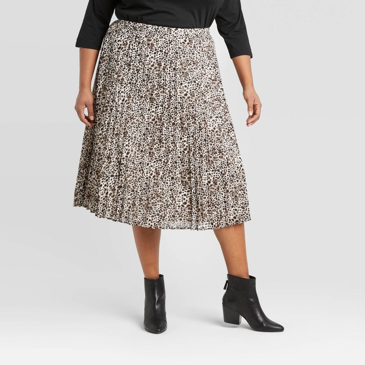 Model in the leopard-print midi skirt