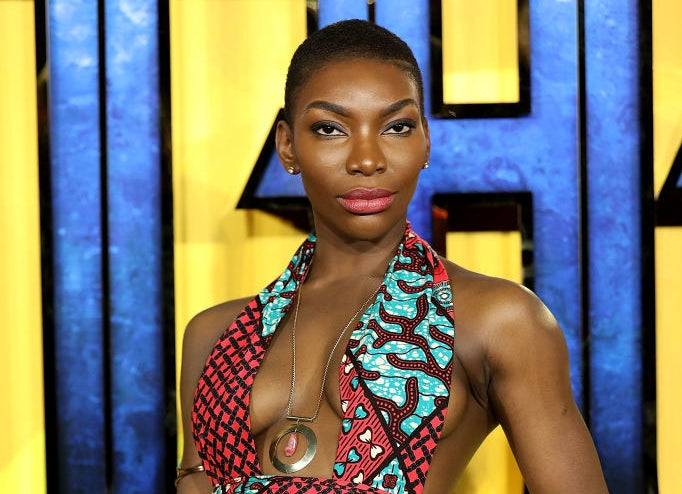 A profile photo of Michaela Coel posed on the red carpet.