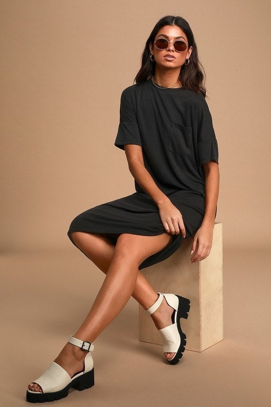 Model in black midi T-shirt dress with a front chest pocket