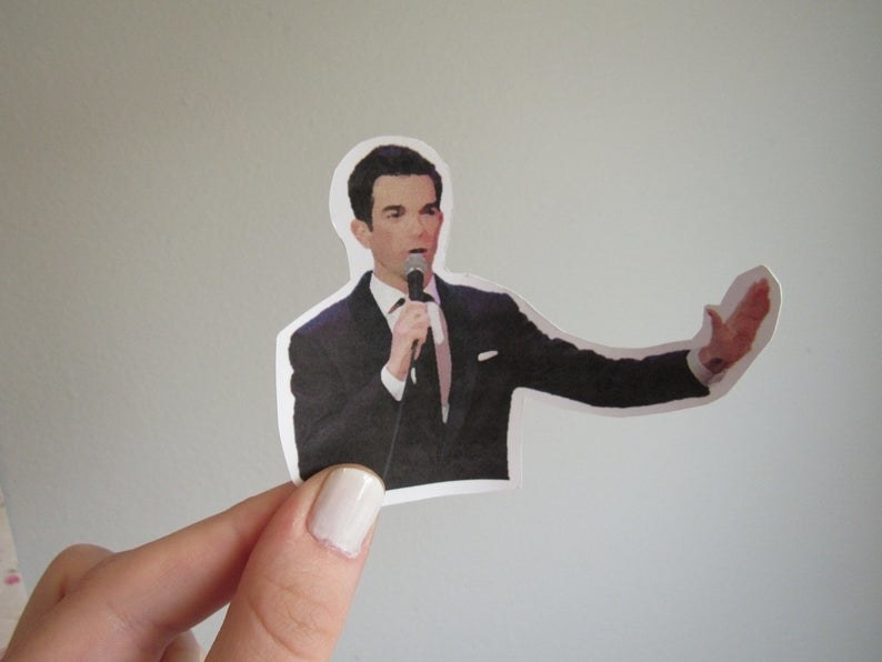 a sticker of john mulaney doing stand up comedy