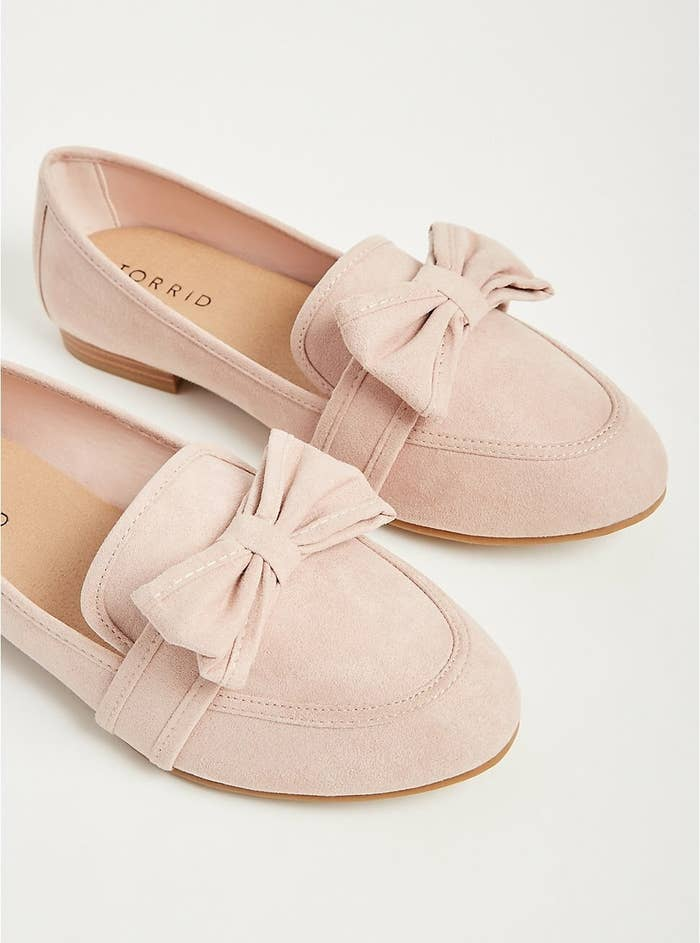 A pair of faux suede shoes with a tiny heel