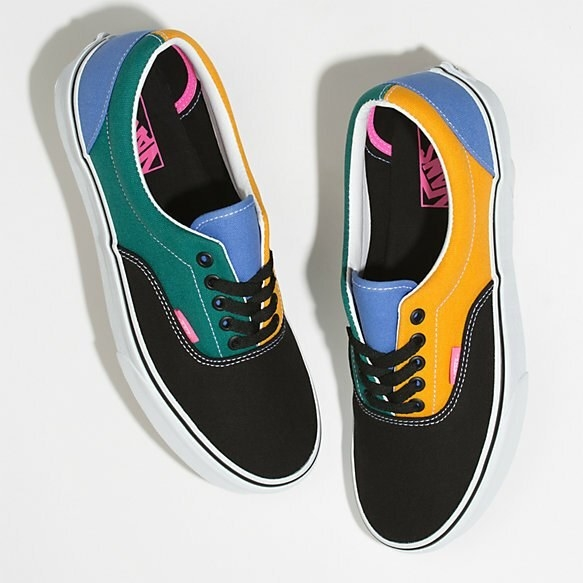 Canvas sneakers with a white rubber sole and multi-colored fabric panels. There are laces, but these could also be slipped on.