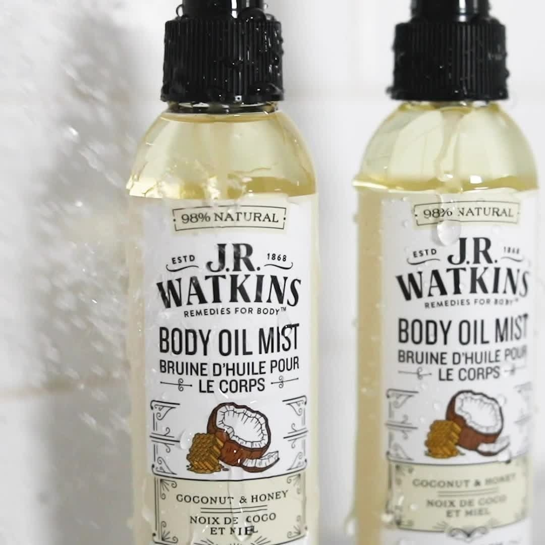 A close up of the body oil mist in the body as water splashes onto it