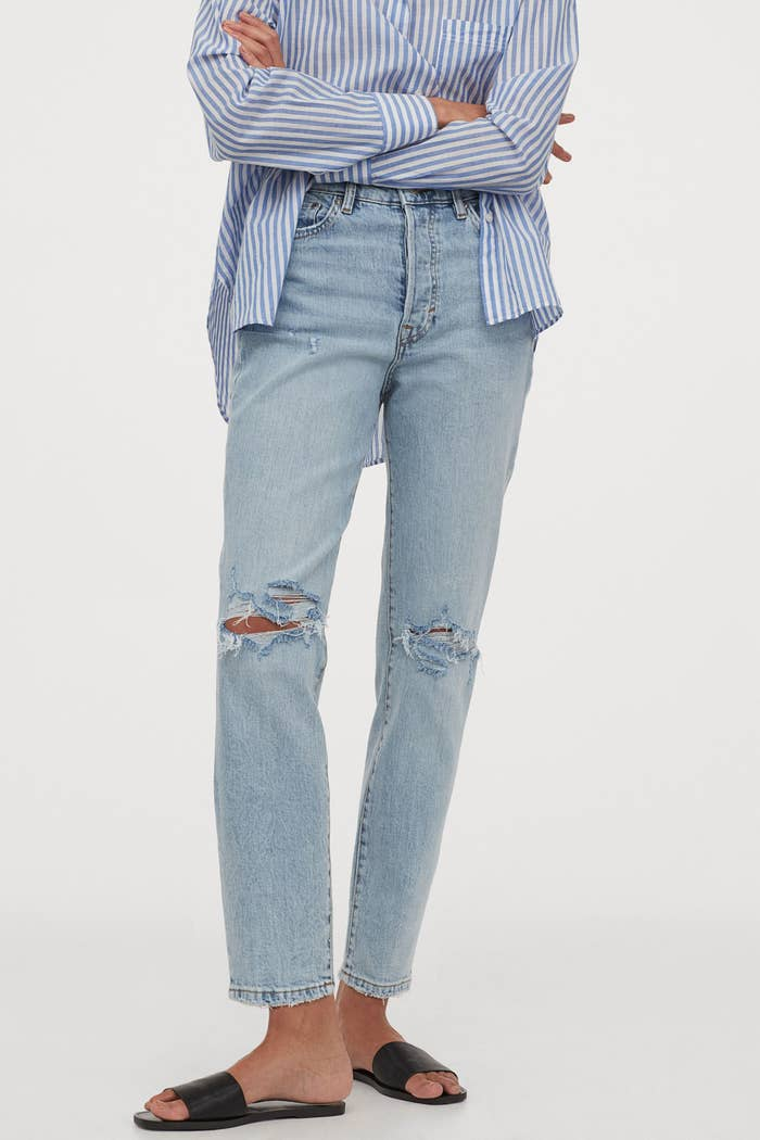 Model in the straight-leg jeans with small knee holes