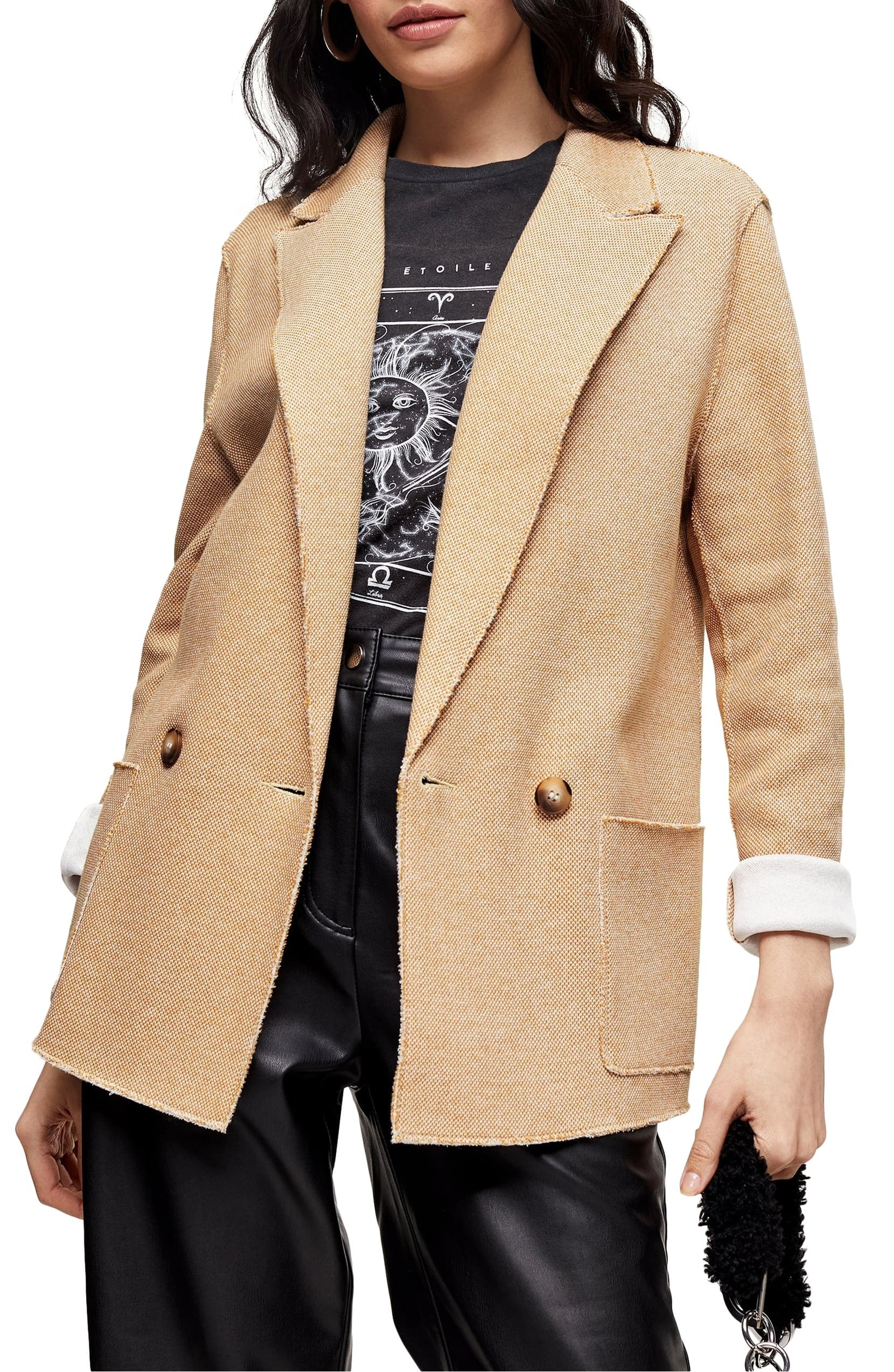 Model in the oversized blazer in tan with two buttons and pockets