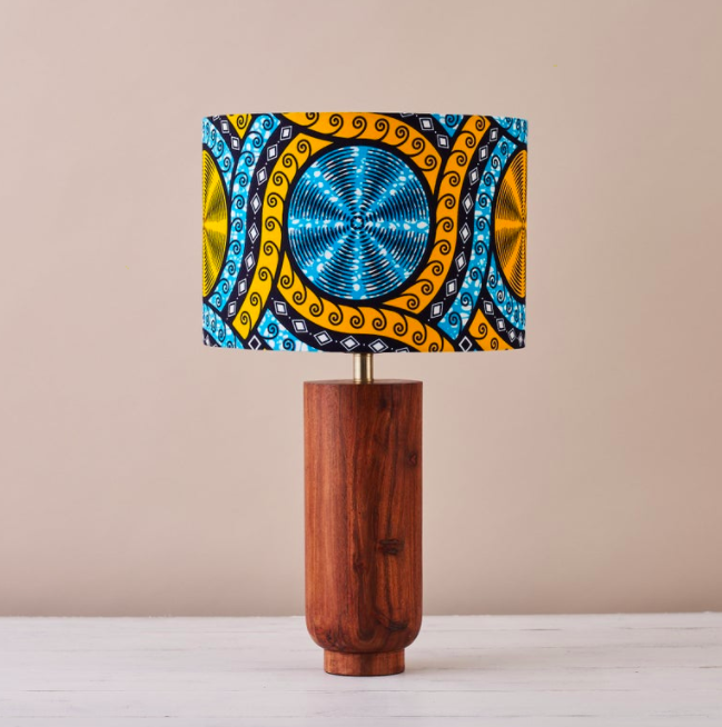 An African wax print drum lampshade in a blue and yellow geometric pattern