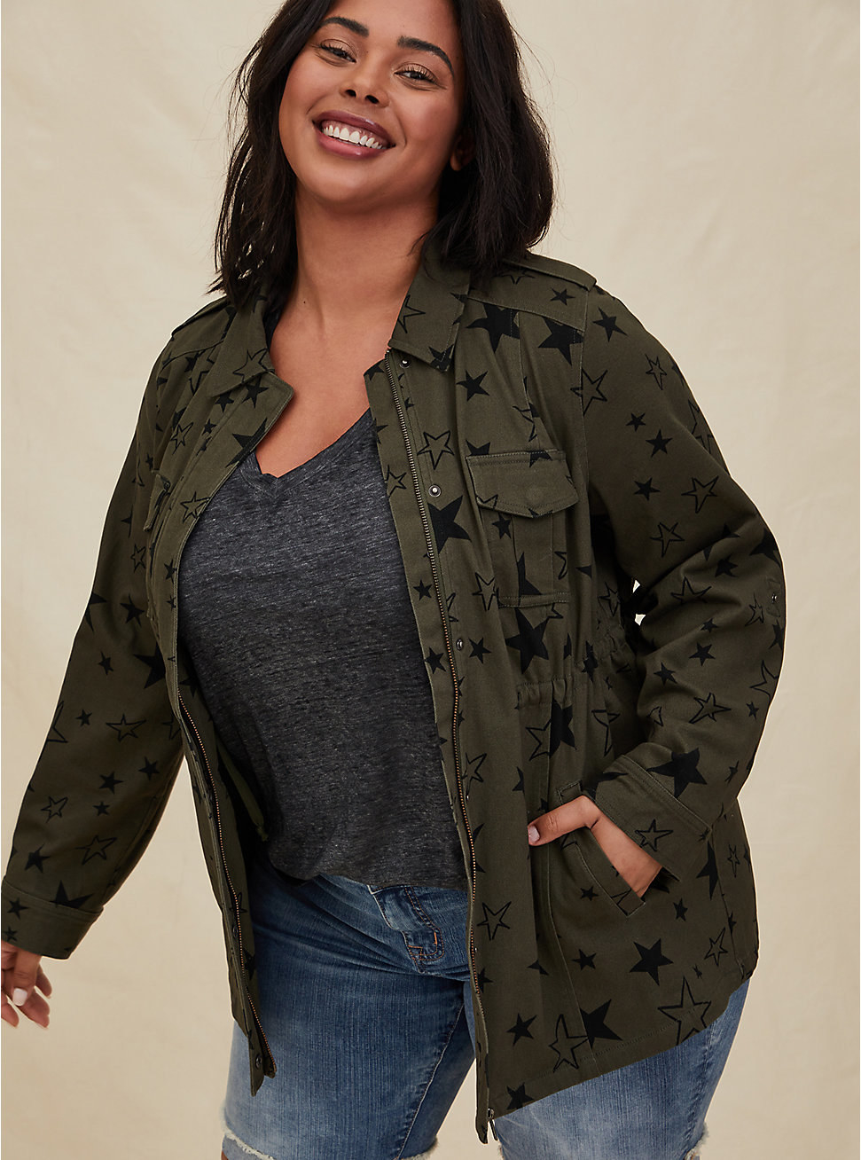 Model in the olive green, star-patterned jacket