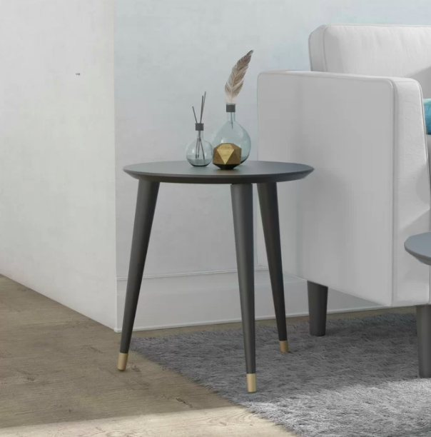 A silver end table with glass vases on top