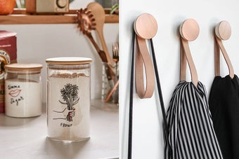(left) Glass container with wood lid and illustration of a hand holding a bouquet of flowers on it (right) Set of three cooper hooks with leather straps holding assorted items on a wall