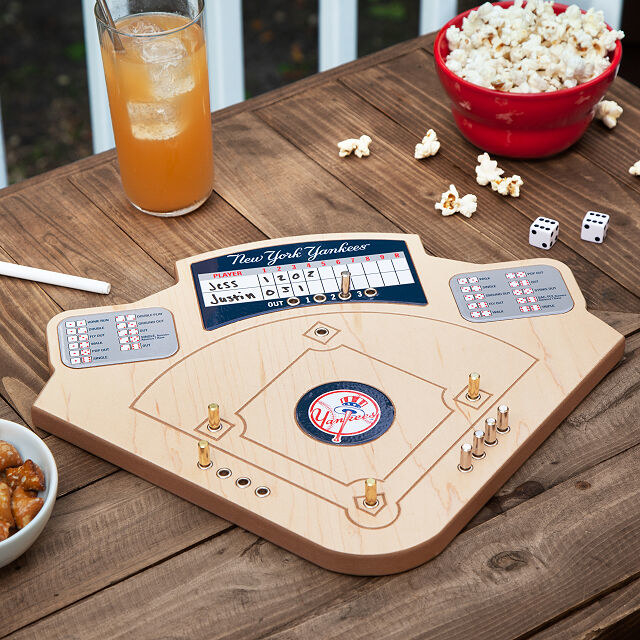 The home team baseball game laid out on a table