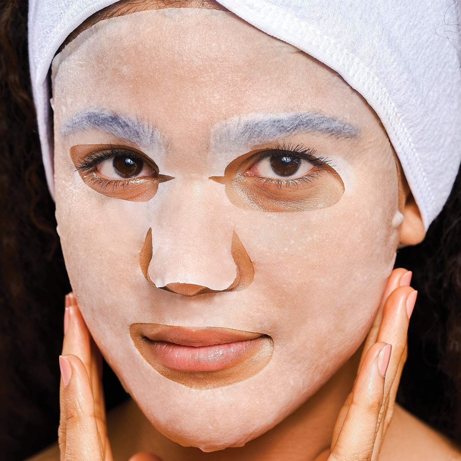 A person wearing the sheet mask on their face