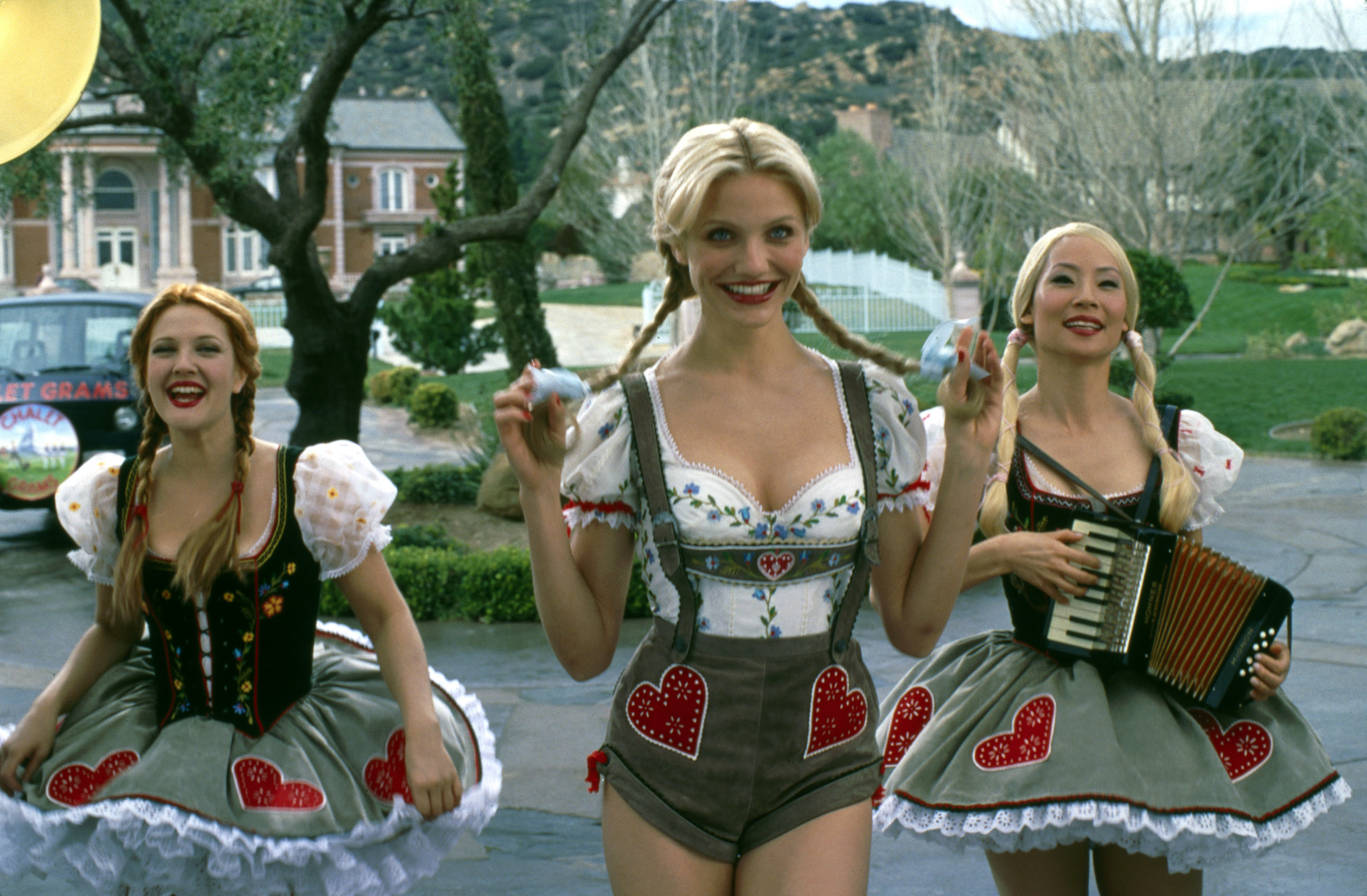 Drew Barrymore, Cameron Diaz, and Lucy Liu in sexualized costumes in Charlie's Angels