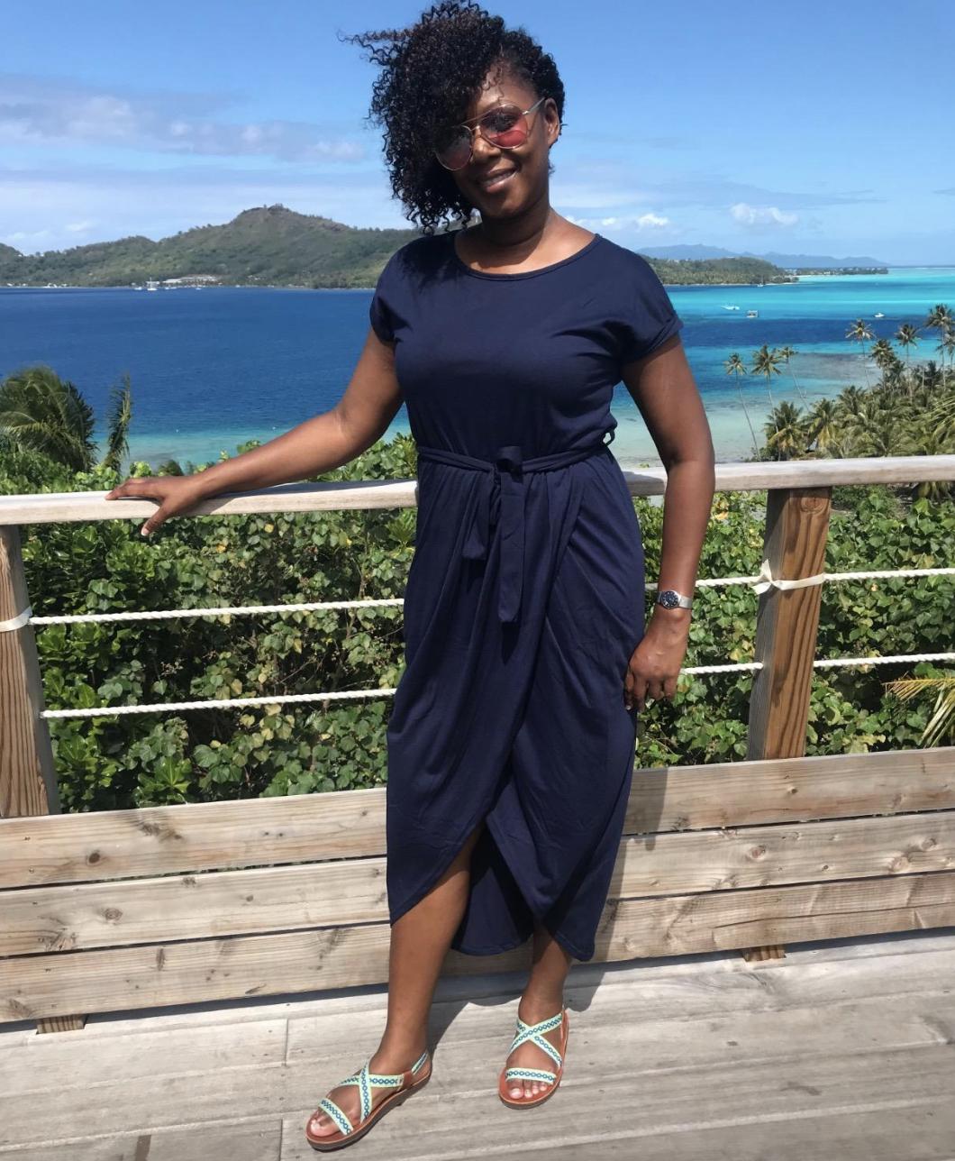 reviewer wearing dress in dark blue
