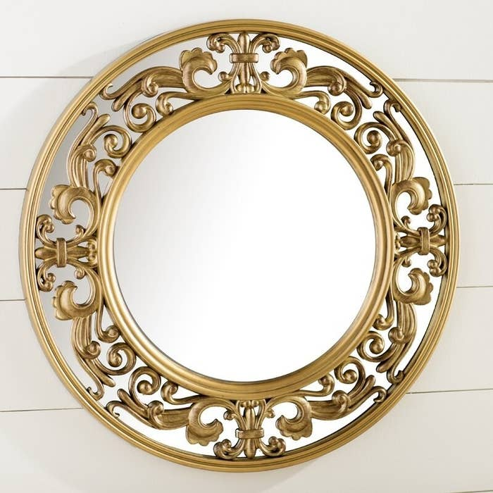 The mirror with a filigree frame
