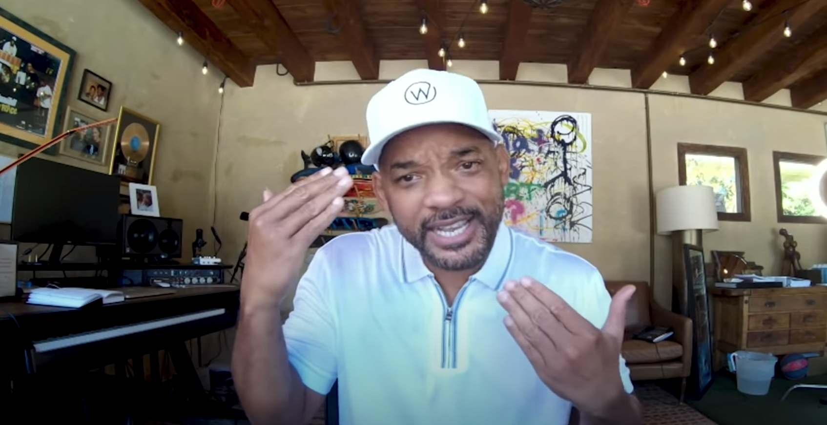 Will Smith makes a hand gesture to show his confusion about police brutality