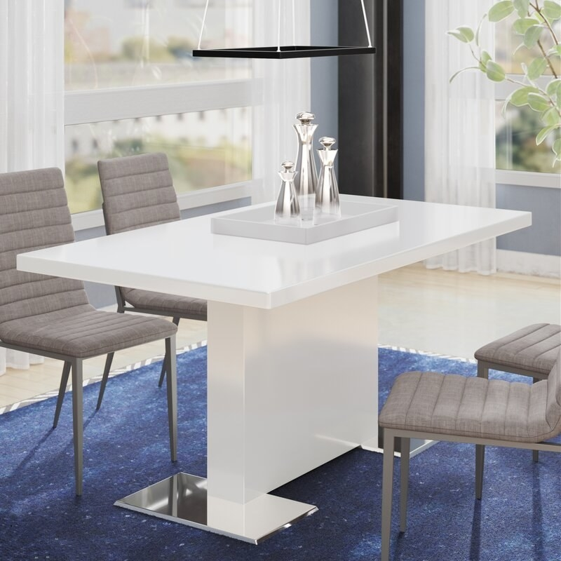 A white rectangular table with a glossy look and a single rectangle as a base