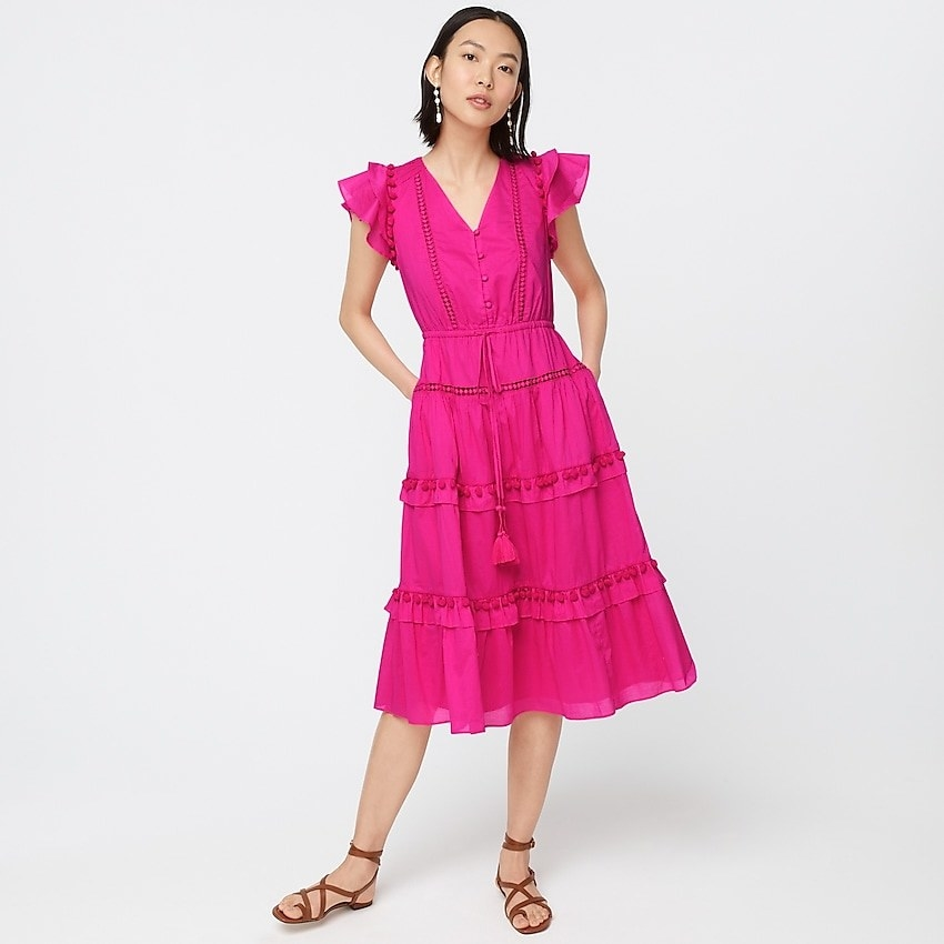 Model in a pink tiered sleeveless dress