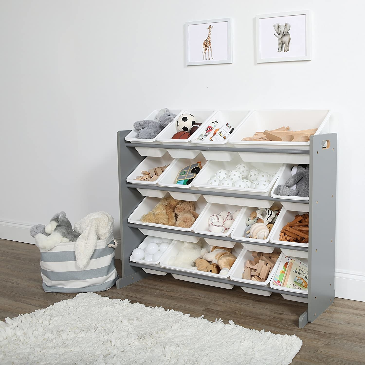 A large bookcase frame with four shelf units, each with four plastic containers of varying sizes. The containers are at an angle, making them easy for children to see inside.