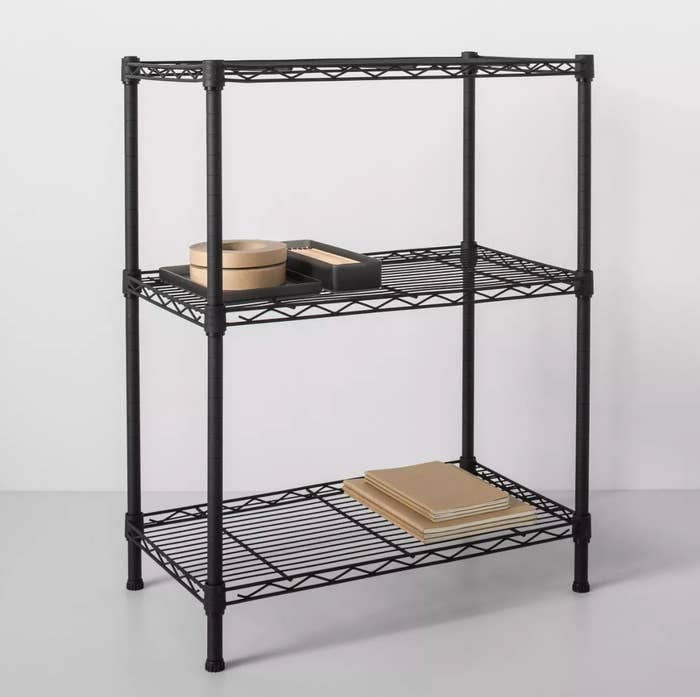 A three-level black wire metal shelf