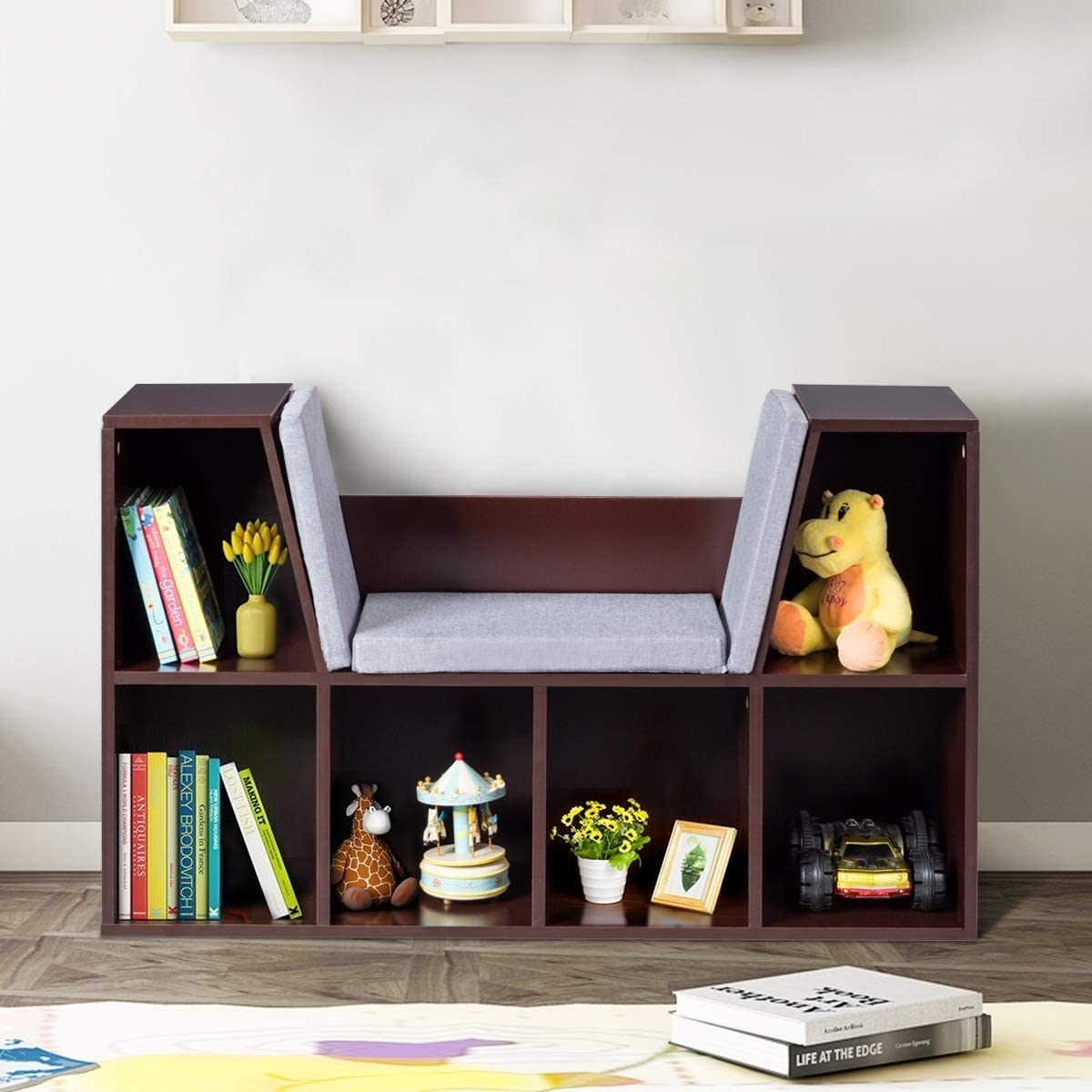 A five-shelf bookcase with a padded seat in the center