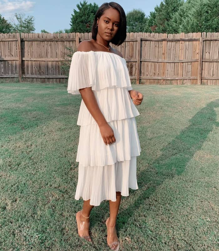 reviewer wearing the white midi dress