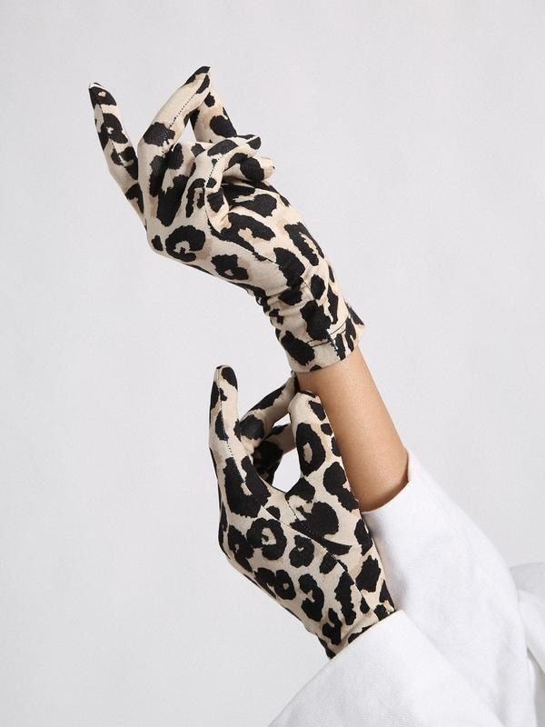 person wearing cheetah print gloves