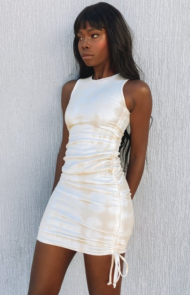 model in tight white and beige tank dress with ruched sides