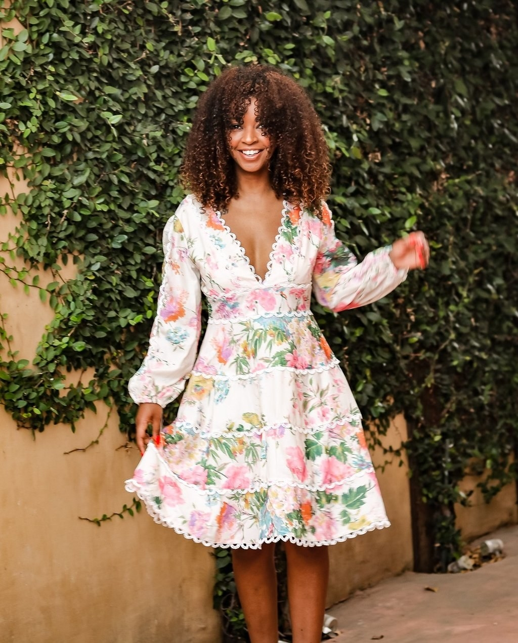 model in knee length long-sleeve dress with multicolor floral
