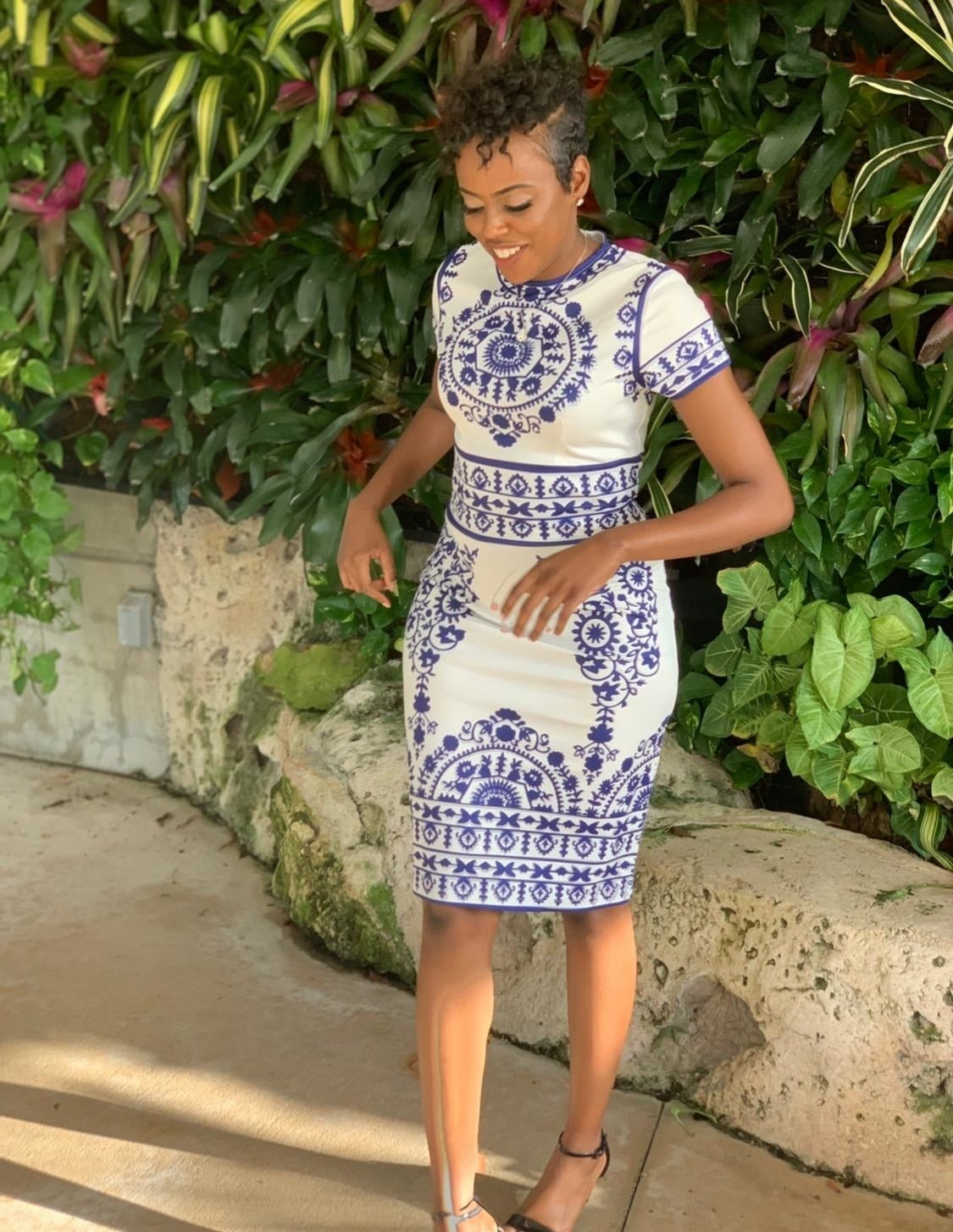 Reviewer wearing the short-sleeved dress in white with blue pattern all over