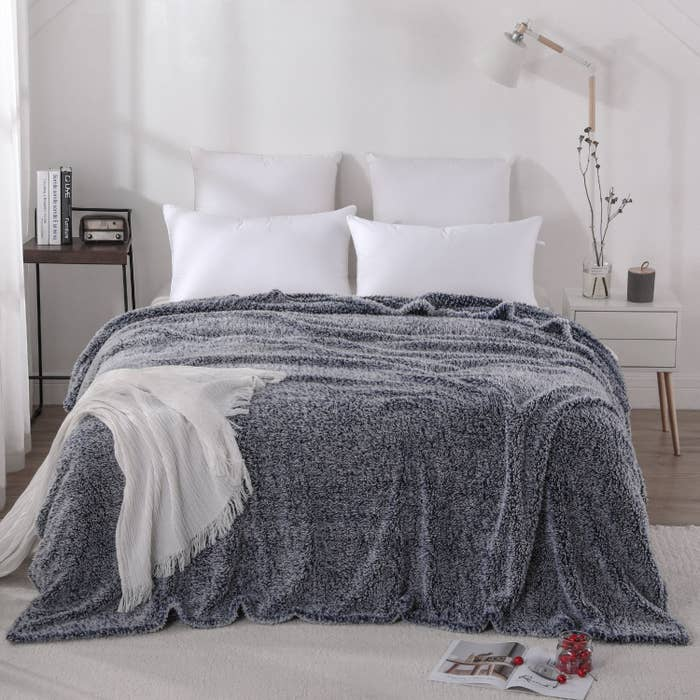 A furry blue blanket atop a bed