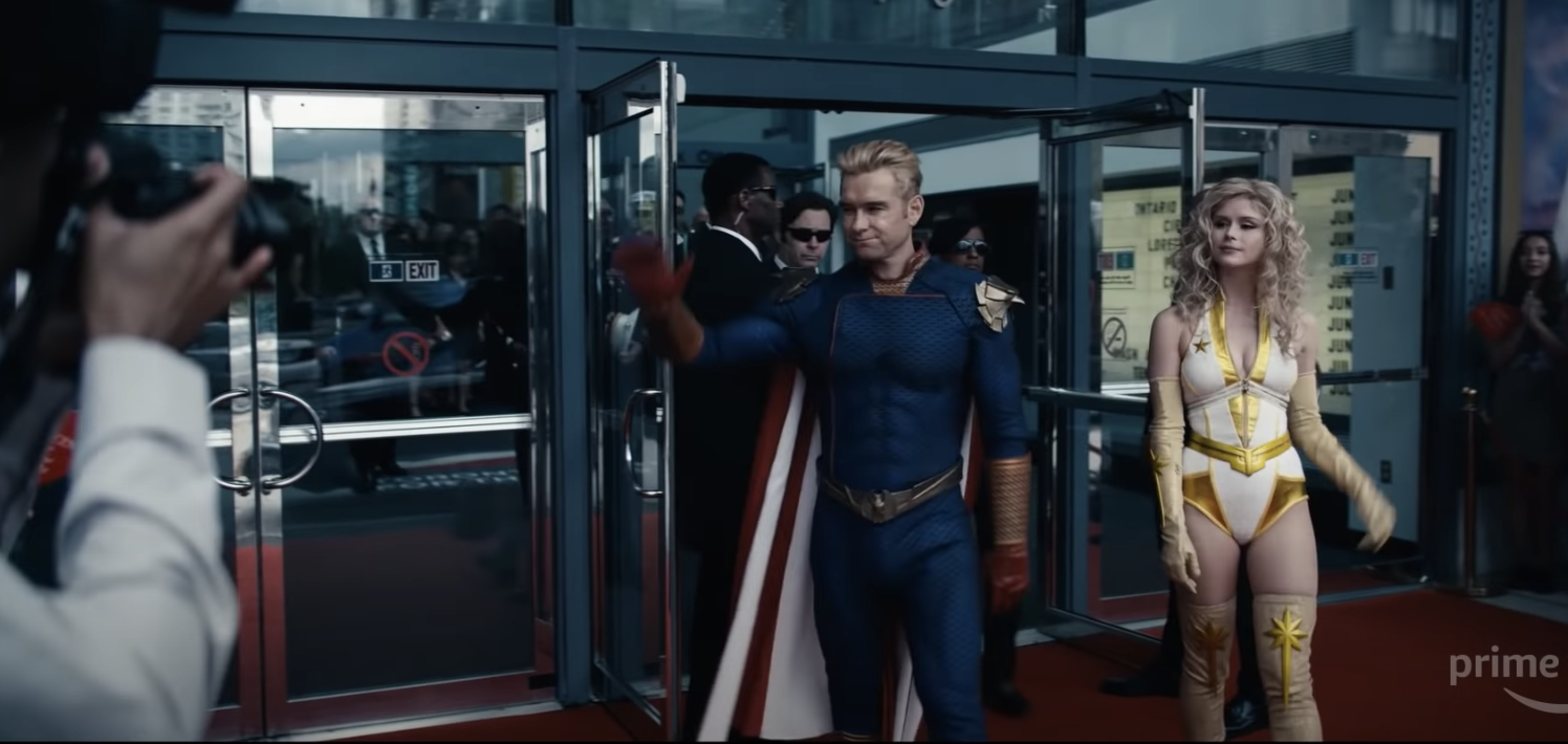 Homelander and Annie exiting Vought's headquarters
