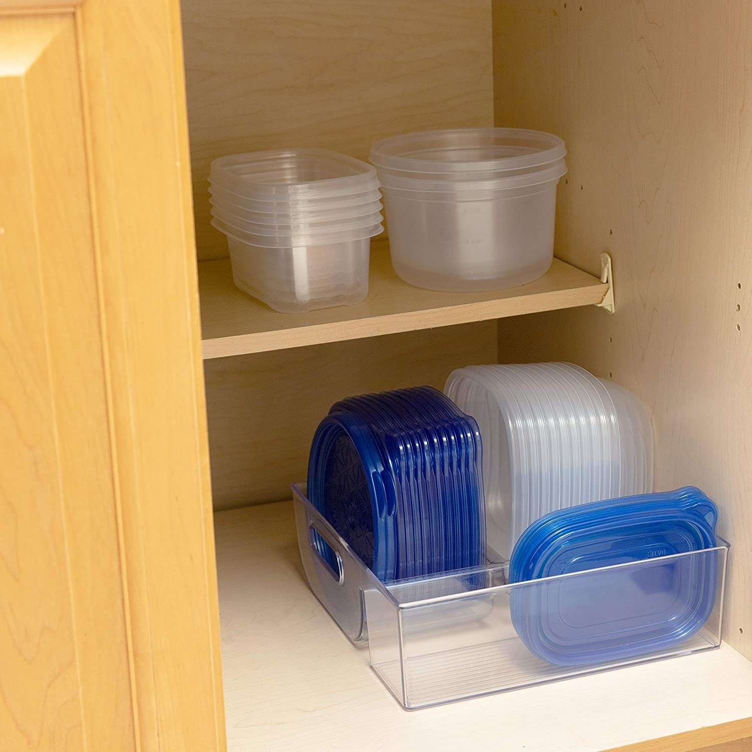 A plastic container organizer with three compartments for neatly storing lids and containers in each separate compartment