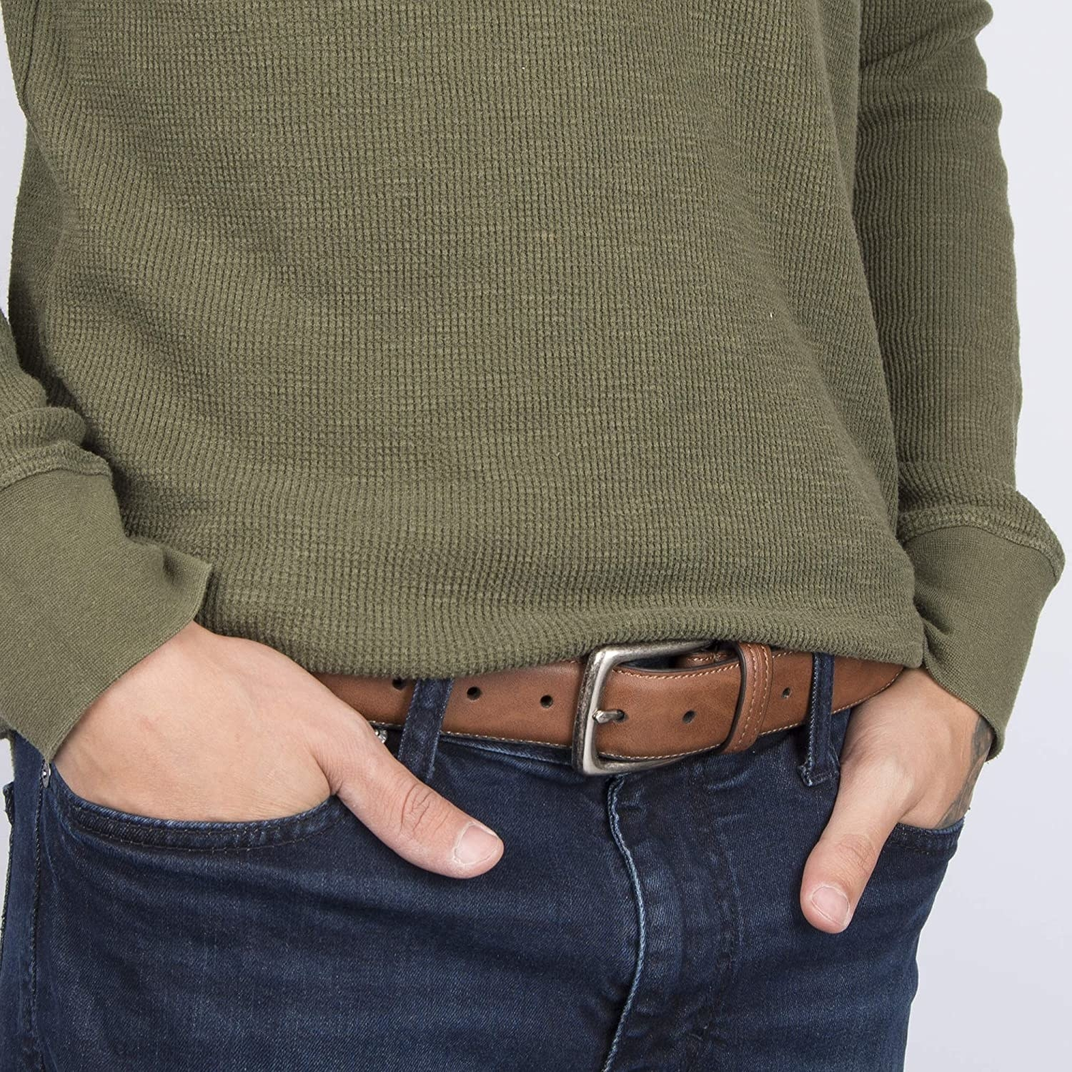 A person wearing the belt with their hands in their pockets