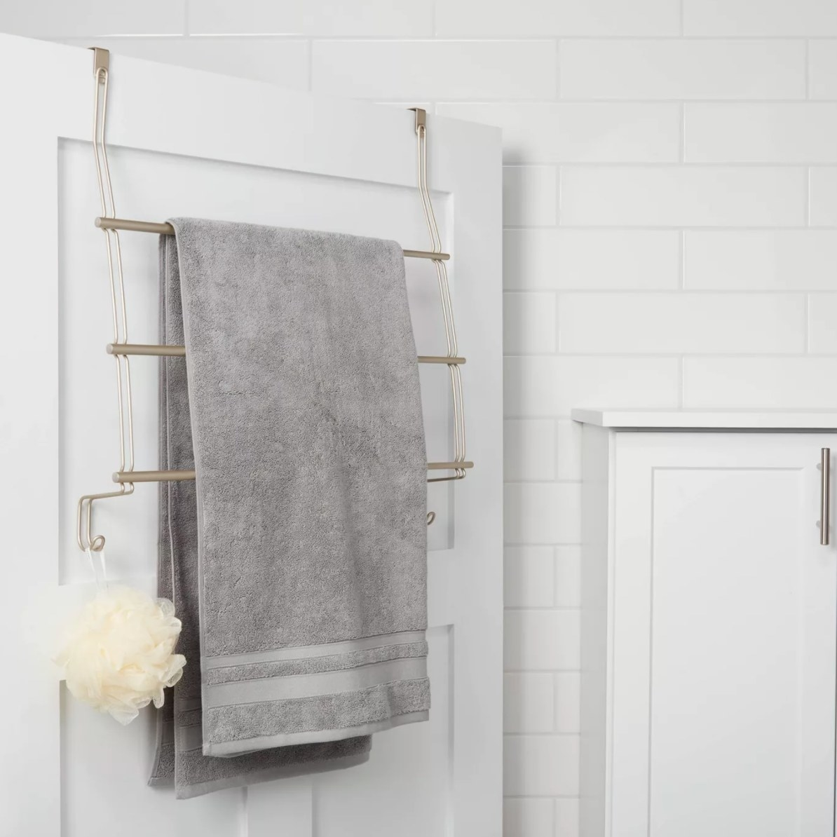 A metal three-bar, towel rack with hooks