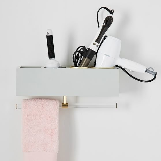 A rectangular cubby shelf with two square storage holes and two round holes, each with metal casings for hot tools. The towel hanger is attached to the bottom.