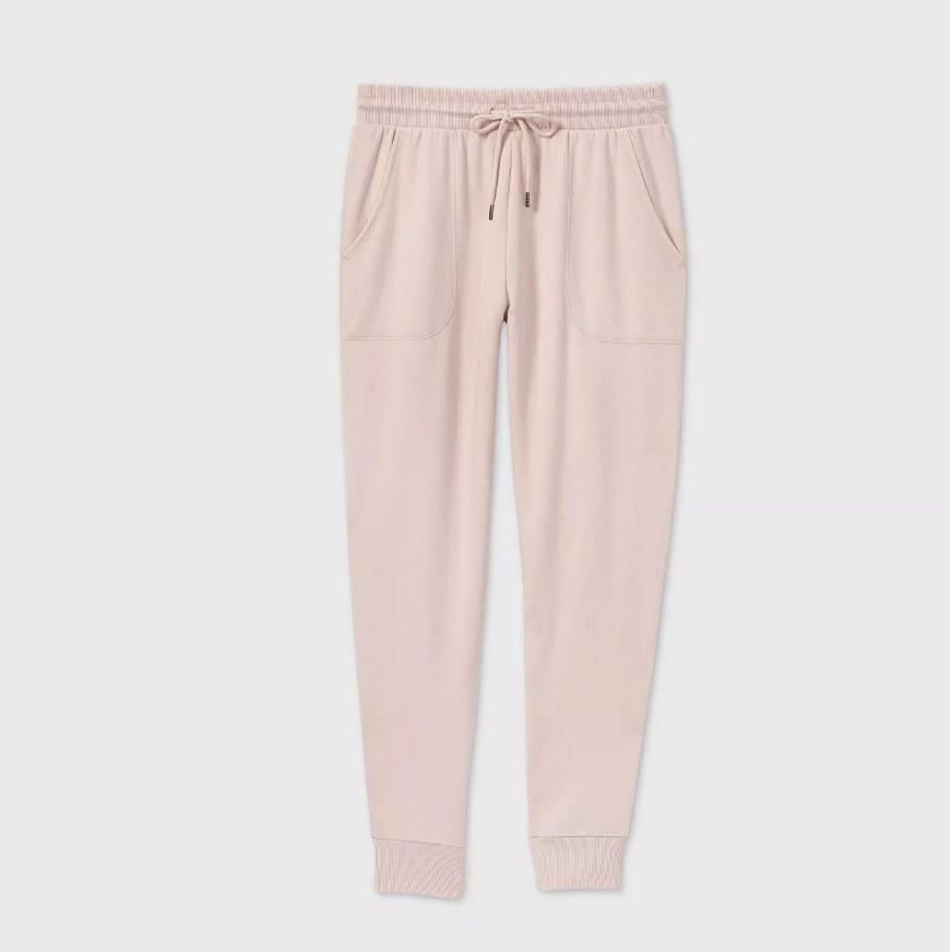a pair of blush colored sweatpants