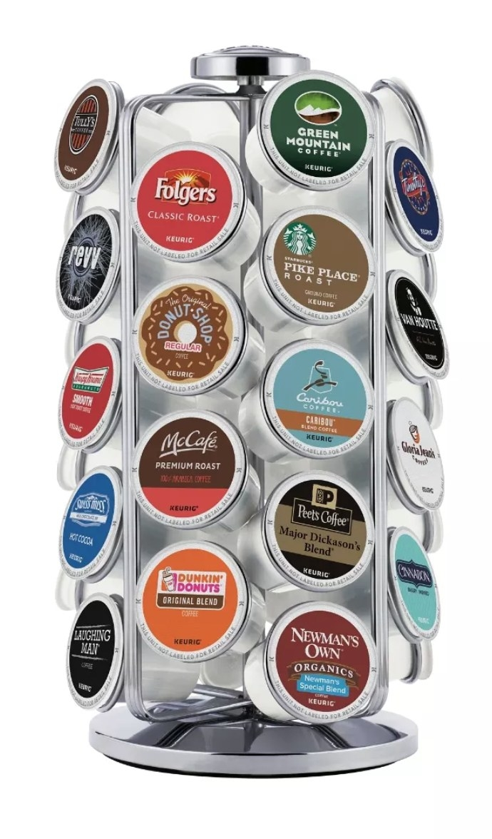 A metal carousel filled with different brands of K-cups