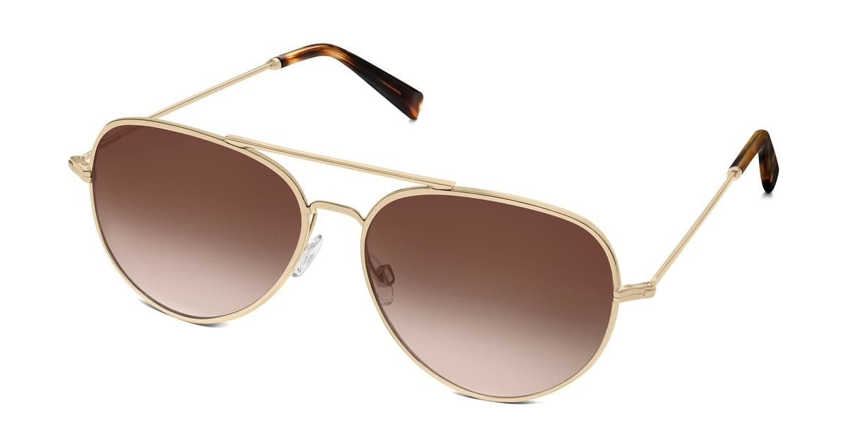 The sunglasses with gold frames and brown lenses