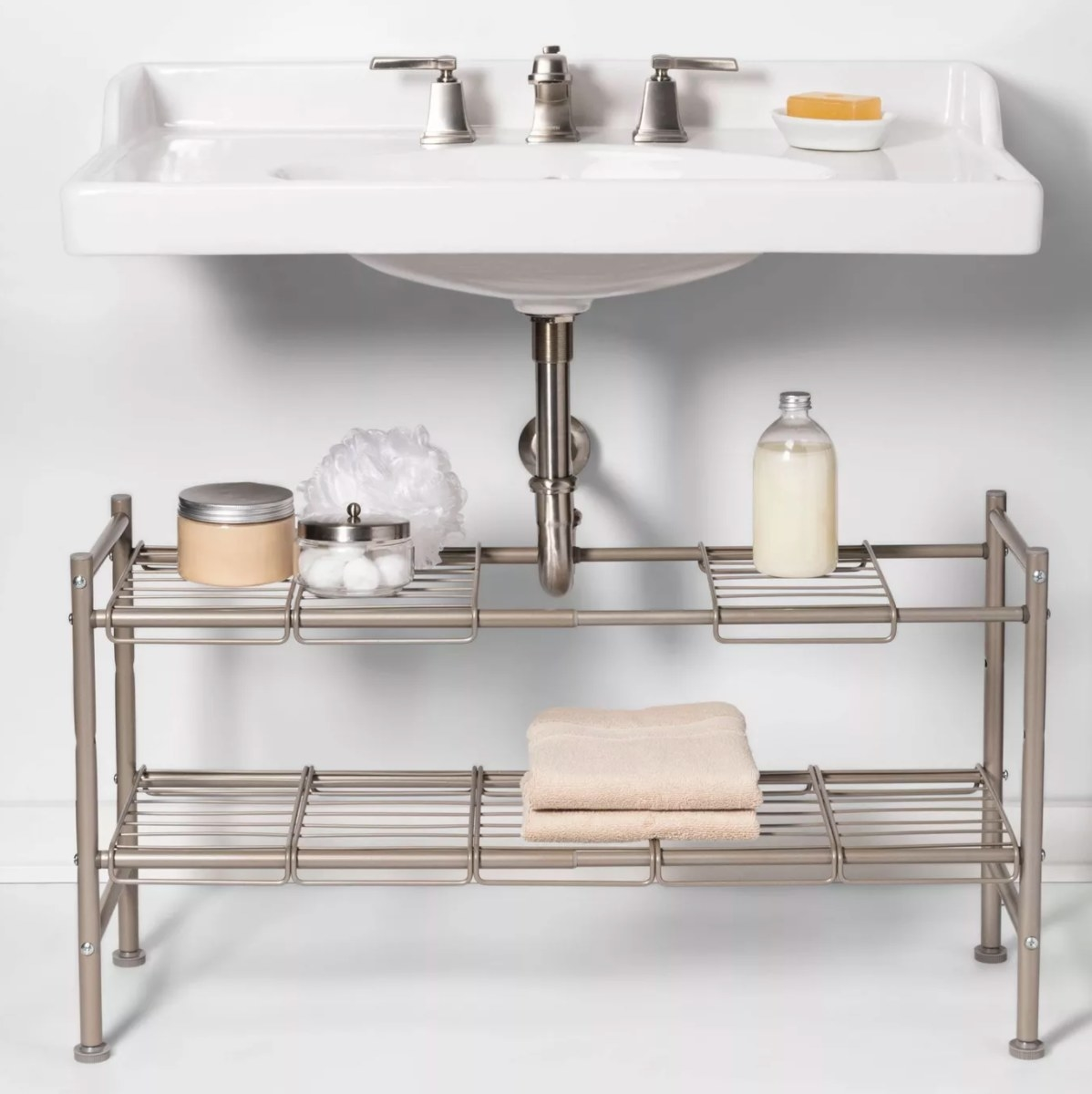 A wire metal tow shelf unit that can be arranged under the pipes of a sink