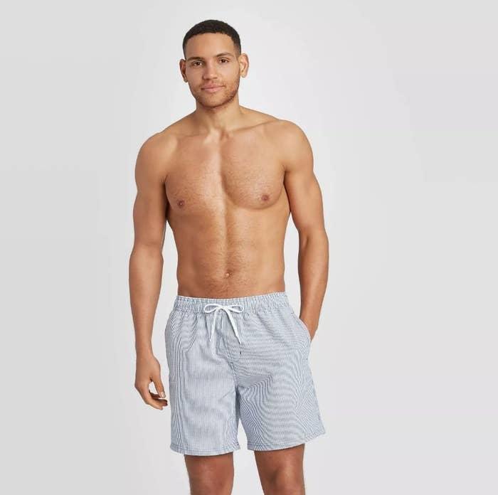 a model kin light grey seersucker swim trunks