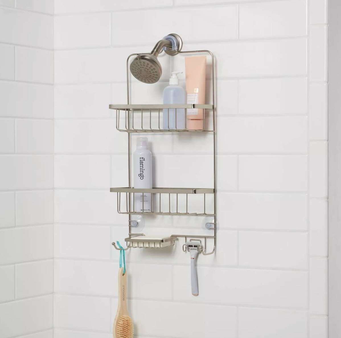 A metal shower caddy with two shelves, hooks, and a soap dish