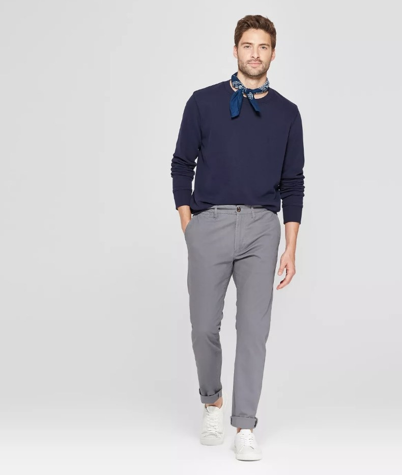 a model in grey chinos