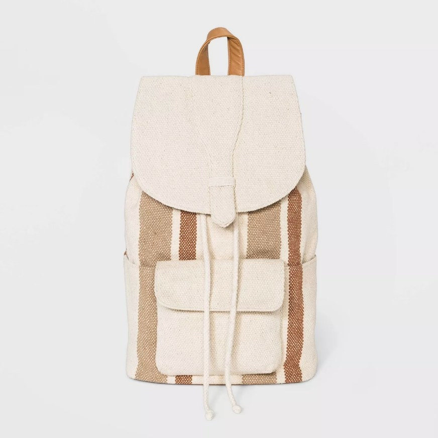 a canvas backpack with vertical stripes of various brown colors