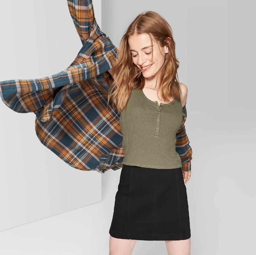 a model wearing a black mini skirt