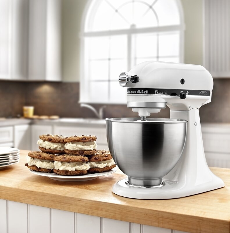 The KitchenAid stand mixer in white with an attached bowl