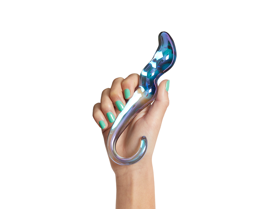 model holds bendy dildo with blue glittery inside and hook shaped tail