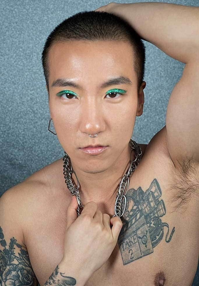 A model wearing the green glitter liner all over their eyelids