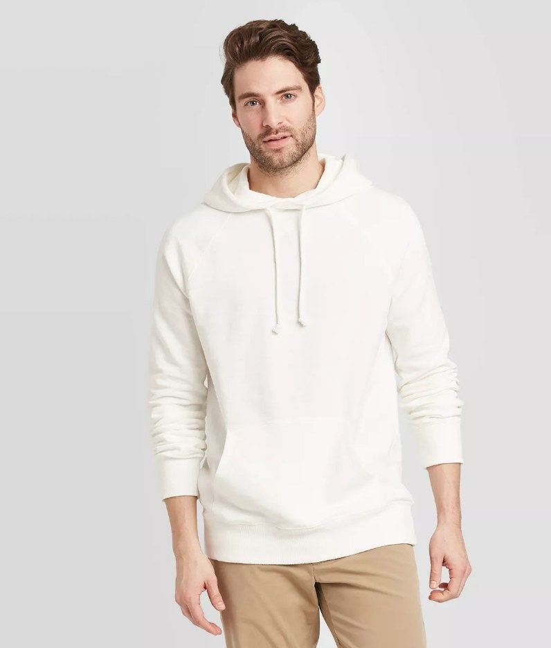 a model in a white hoodie